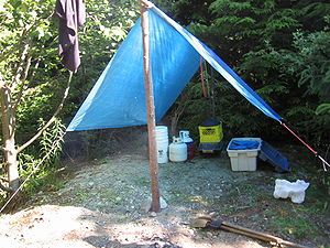Improvised tarp shelter
